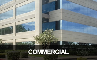 Image of a modern, glass commercial building. Call us for all your commercial locksmith needs.